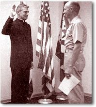 Father Capodanno being sworn as a Navy Lieutenant of the Chaplain Corps by Commander E. M. Tollgaard in Honolulu, Hawaii